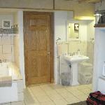 Bath - toilet, tub & shower behind the door.
