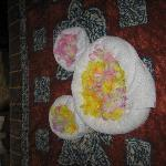 On our bed when we arrived -- the flowers are leis