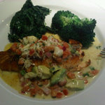A nice grilled fish with some crabmeat, pico spinach and broccoli