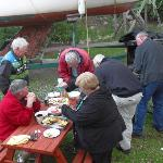 Guests at an oyster barbecue at Captain's Table B&B