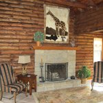 Spacious, open livingroom with stone fireplace