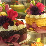 all cakes are very beautifully decorated with flowers
