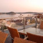 Terrace outside suite with a view over Grimstad