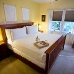 The Chardonnay Deluxe Room king bed with private courtyard and deck