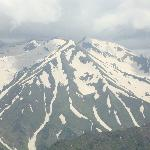 the snow laden mountains