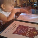 My daughter surveying the menu at Kalaheo Cafe :)