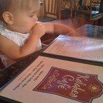 My daughter surveying the menu at Kalaheo Cafe :)