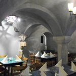 Dining area in cavern with vaulted ceilings