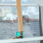 Sash window propped up with wood & varnish pot!!