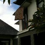 Broken blind hanging loosely outside villa