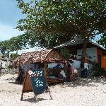 Massage on the beach and bar behind