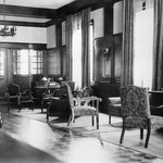 Lobby with historic piano,radio,and rich wood detail