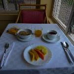 Breakfast is in a nice corner facing the gardens.  Starts with tea, fresh juice, a fruit platter