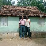 my son and me,in front of our village house