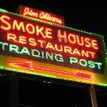The Old Smoke House neon sign lighting the way for travelers.
