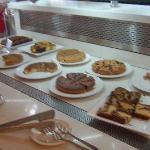 Cakes and sweets at the breakfast buffet (cereal in the background)