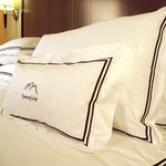 Goose down comforters & pillows; 100% Egyptian-sateen cotton linens.  Experience the personal to