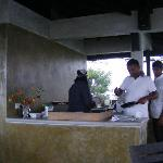 the outdoor kitchen, with the 2 owners + their waiter