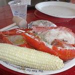 steamed lobster, baked potato and corn