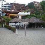 From the beach. The private palapas. You can see the blue private pool of room 9.