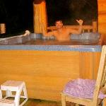 Lovin the Outdoor Hot Tub covered by the Cabin - Awesome!