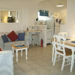 Comfortable living, dining and kitchen areas of studio cottage