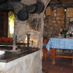 the wood fired oven and dining table outside