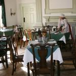Servers wear 18th Century costumes to complete the historical ambiance.
