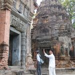 Explaining the carvings to us at Preah Ko