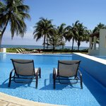 Two chaise lounge chairs facing the Caribbean