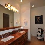 Each master bath offers two sinks, Jacuzzi, and separate shower