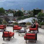 Enjoy a glass of wine on the rooftop patio