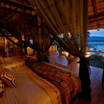 Wake up to an incredible view onto the river at Chamilandu Bushcamp, Luangwa, Zambia