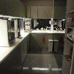 self service kitchen with fridge, microwave, coffee/tea, hot water dispenser