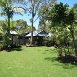 Landscaped native gardens provide privacy for each cabin