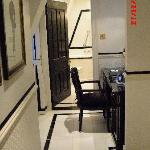 Hallway with bathroom at end