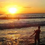 Surfing at sunset - Santa Teresa beach