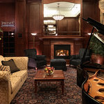 Curl up by the fire and enjoy coffee, tea and music from our baby grand
