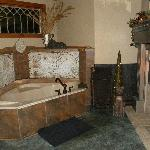 Spa bathtub for 2, with fireplace burning