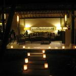 View of candle-lit walkway into villa