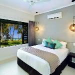 Main bedroom of a 2 bedroom apartment - absolute beachfront and overlooking one of the resorts 2