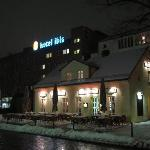 View of hotel at night in the snow from Alt-Reinickendorf
