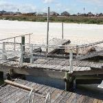 Dock in disrepair and filled in with sand
