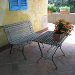 The Villa (private accomodations) has a beautiful terrace with tables, chairs, trees, flowers an
