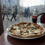 Cheap pizza and a view of the street
