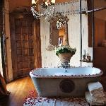 The tub in our room that was filled with HOT water, bubbles and rose petals PRIOR to arrival.