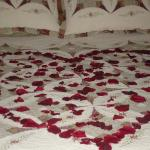 Rose petals on the kings size bed