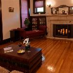 Enjoy a glass of wine while lounging in the historic living room while gazing into the flames of