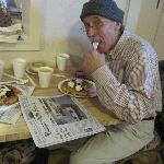 Hubby enjoying a really good, free breakfast.