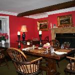 Our cosy red dining room where we offer dinner on request